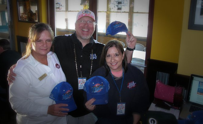 Rennae, the head honcho at Tailgatez, Dave Kallaway & Stacy Cole stylin' the Fred Mueller hats, cool Green Bay gear and a chance to win a Mazda 3!!! Thanks for coming out guys!!