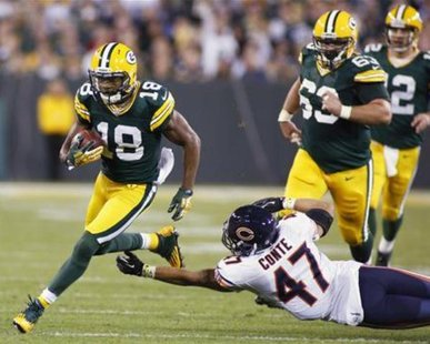 Chicago Bears safety Chris Conte (47) tries to grab Green Bay Packers wide receiver Randall Cobb (18) in the first half during their NFL football game in Green Bay, Wisconsin September 13, 2012. REUTERS/Darren Hauck