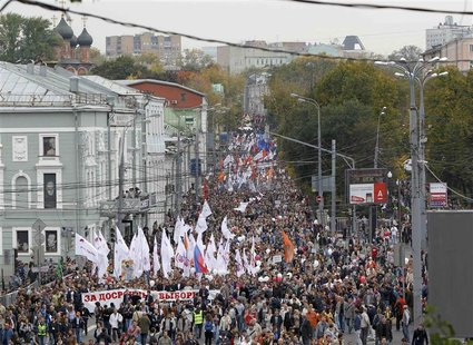 "Opposition supporters take part in the ""March of Millions"" protest rally in Moscow, September 15, 2012. Protesters demanded Russia's Preside"