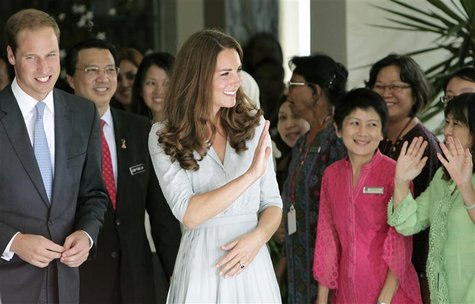 Britain's Prince William and Catherine, Duchess of Cambridge, wave to staff as they leave Hospis Malaysia, the largest hospice in the countr