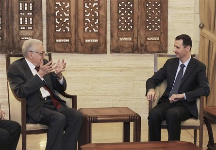 Syria's President Bashar al-Assad (R) meets with United Nations (U.N.)-Arab League peace envoy for Syria Lakhdar Brahimi in Damascus Septemb