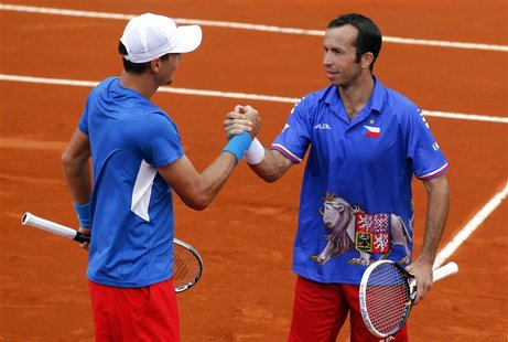 Tomas Berdych (L) and Radek Stepanek of Czech Republic celebrate after winning their Davis Cup World Group doubles match against Eduardo Sch