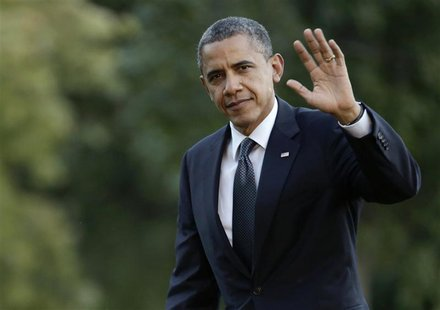 U.S. President Barack Obama waves as he returns to the White House in Washington September 13, 2012, after campaigning in Colorado. REUTERS/