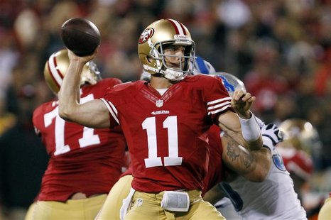San Francisco 49ers quarterback Alex Smith throws a pass against the Detroit Lions during their NFL football game in San Francisco, Californ
