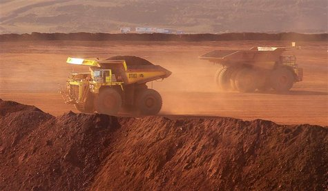 Heavy equipment operates at Fortescue Metals Cloudbreak iron ore mine, about 250km (155 miles) southeast of Port Hedland in Western Australi