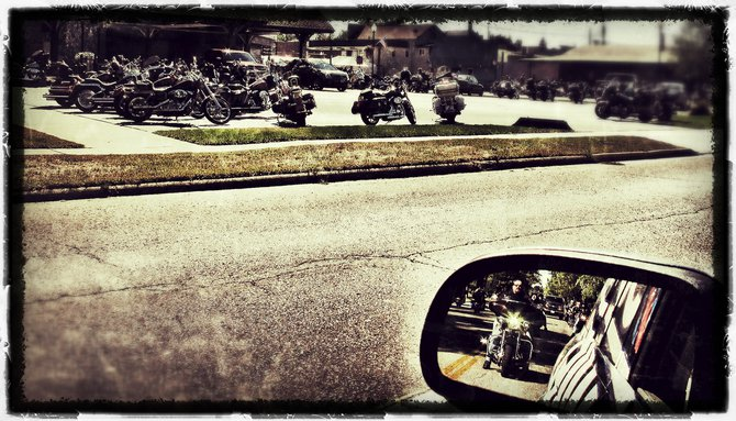 Motorcycles parked everywhere..including my rear view mirror!!