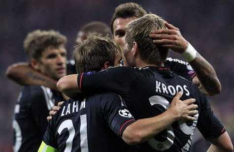 Bayern Munich's Toni Kroos (R) celebrates with teammates after scoring their second goal against Valencia during their Champions League Grou