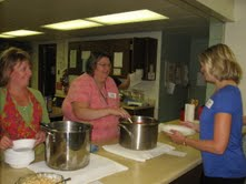 Jaclyn Slavens and Trisha Loiselle serve Volunteer Brenda Stecker