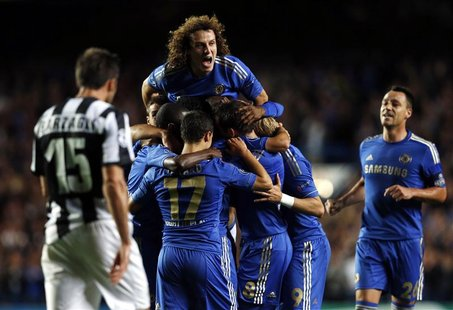 Chelsea's Oscar (unseen) celebrates with teammates after scoring a goal against Juventus during their Champions League soccer match at Stamf