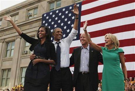 U.S. President Barack Obama, first lady Michelle Obama, U.S. Vice President Joseph Biden, and his wife, Dr. Jill Biden, all wave after Obama