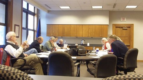 Members of the Windmill Island Strategic Planning Committee meet in Holland City Hall on Sept. 24, 2012.