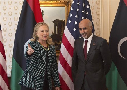 U.S. Secretary of State Hillary Clinton meets with Libyan leader Mohammed Magarief on the sidelines of the United Nations General Assembly i