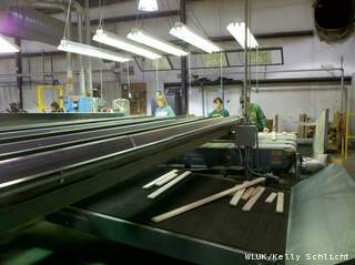 Workers at WD Flooring in Laona, Monday, September 24, 2012. (courtesy of FOX 11).