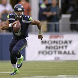 Seattle Seahawks quarterback Russell Wilson runs for a gain against the Green Bay Packers during the second quarter of their Monday night NF