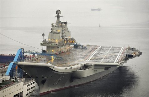 China's first aircraft carrier, which was renovated from an old aircraft carrier that China bought from Ukraine in 1998, is seen docked at D