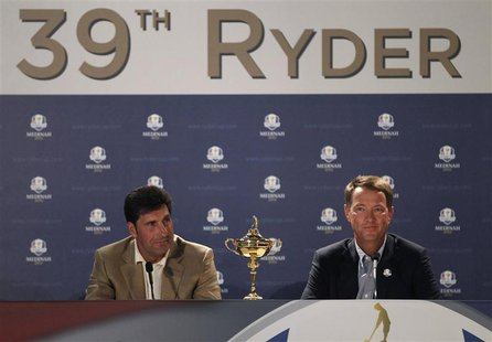 Europe captain Jose Maria Olazabal (L) attends a news conference with U.S. captain Davis Love III after arriving for the 39th Ryder Cup golf
