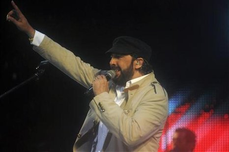 "Dominican singer Juan Luis Guerra performs during the concert ""A Son de Guerra Tour"" at the Olympic Stadium in Santo Domingo June 16, 2012."