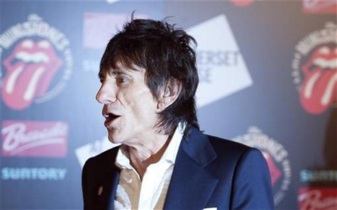 "Ronnie Wood of the The Rolling Stones walks away after posing at the opening of the exhibition ""Rolling Stones: 50"" at Somerset House in Lon"