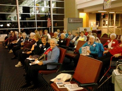 Ladies wait patiently for their veterans to come home from the Never Forgotten Honor Flight, September 24, 2012