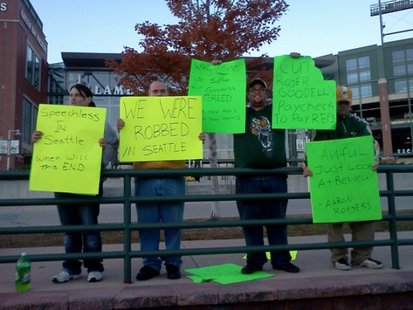 Fans gather on a sidewalk in front of Lambeau Field to register their discontent. (courtesy of FOX 11).