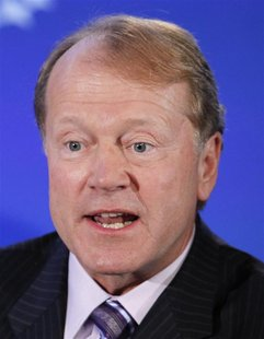 "John Chambers, Chairman and CEO of Cisco, participates in a group discussion on ""Business by Design: Business with Integrity"" during the sec"