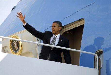 U.S. President Barack Obama waves from Air Force One at Andrews Air Force Base near Washington, September 26, 2012. Obama is traveling to Oh