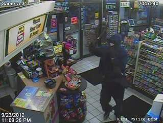 This surveillance photo shows the man who robbed the Kiel Mobil gas station with a hammer Sept. 23, 2012.