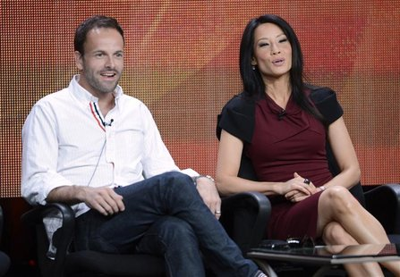 "Cast members Jonny Lee Miller (L) and Lucy Liu participate in a panel for CBS series ""Elementary"" during the CBS sessions at the Television"