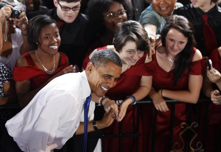 U.S. President Barack Obama poses for a picture with members of Vox Harmonia, from Salem High School as he participates in an election campa