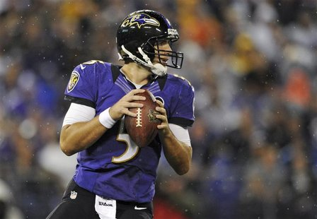 Baltimore Ravens quarteback Joe Flacco looks to pass against the Cleveland Browns during NFL football action in Baltimore, Maryland Septembe