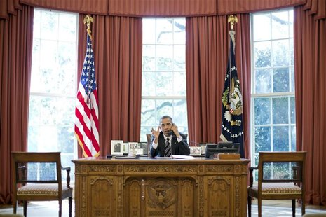 U.S. President Barack Obama speaks on the phone with Israel's Prime Minister Benjamin Netanyahu, in the Oval Office in this September 28, 20