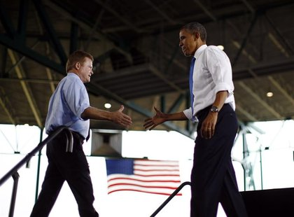U.S. President Barack Obama shakes hands with U.S. Senator Jim Webb (D-VA) at an election campaign rally in Virginia Beach, September 27, 20