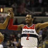 Washington Wizards' John Wall (R) celebrates with teammate Nick Young (L) during overtime of their NBA basketball game against the Toronto R