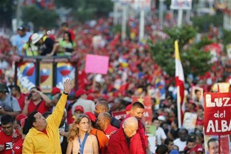 Venezuela's President Hugo Chavez waves at supporters during a campaign rally in Guarenas in the state of Miranda September 29, 2012. REUTER