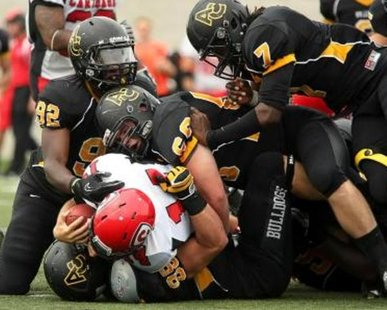 A NIGHTMARE IMAGE: The swarming Adrian defense seen here in this action photo taken earlier this season versus Carthage was seen in person by Hope during a 24-0 loss at Adrian on Sept. 29, 2012. (photo courtesy Adrian College)