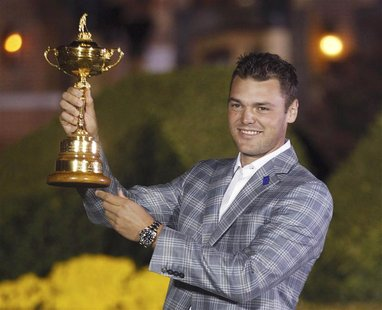 Team Europe golfer Martin Kaymer of Germany holds the Ryder Cup as he poses after the closing ceremony of the 39th Ryder Cup at the Medinah