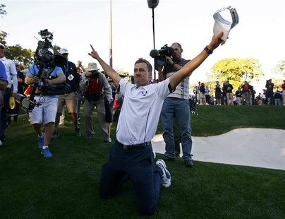Team Europe golfer Ian Poulter of England celebrates winning the Ryder Cup for Europe during the 39th Ryder Cup singles golf matches at the