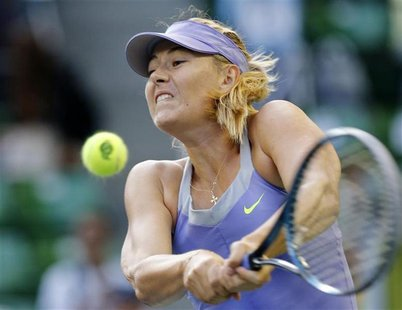 Maria Sharapova of Russia returns a shot against Lucie Safarova of the Czech Republic during their third round women's singles match at the