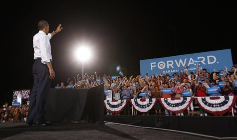 U.S. President Barack Obama waves to supporters during a campaign rally at Desert Pines High School in Las Vegas, Nevada September 30, 2012.