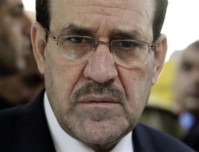 Iraq's Prime Minister Nuri al-Maliki attends the opening ceremony of the Defence University for Military Studies inside Baghdad's heavily-fo