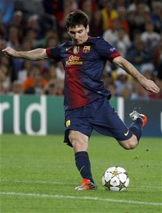 Barcelona's Lionel Messi kicks the ball during their Champions League Group G soccer match against Spartak Moscow at Nou Camp stadium in Bar