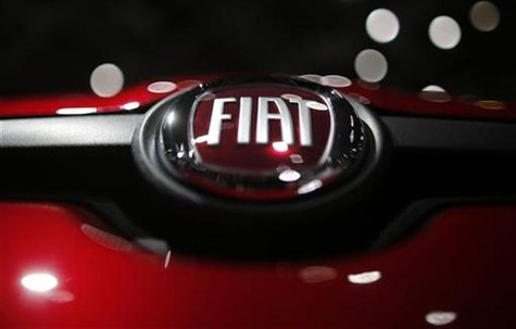 A company logo is seen on a Fiat car displayed on media day at the Paris Mondial de l'Automobile, September 28, 2012. The Paris auto show op