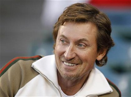 Hockey great Wayne Gretzky watches the American League baseball season opening game between the Los Angeles Angels and the Minnesota Twins i