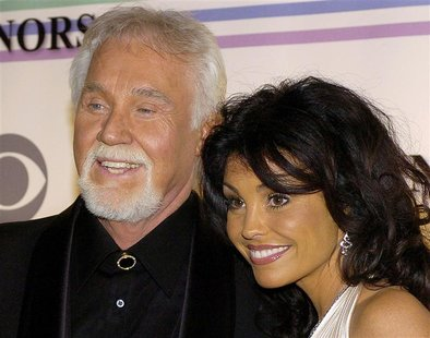 Country singer Kenny Rogers and his wife Wanda pose for photographers as the arrive at the Kennedy Center for the 29th Annual Gala in Washin