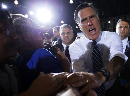 Republican presidential candidate and former Massachusetts Governor Mitt Romney greets audience members at a campaign rally in Denver, Color