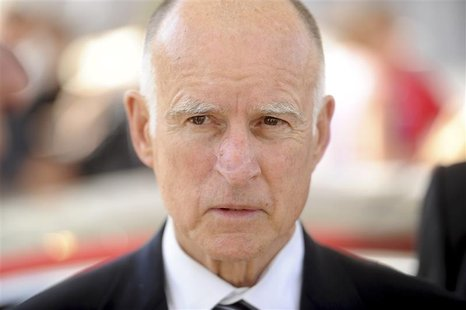 California Governor Jerry Brown attends a celebration at Tesla's factory in Fremont, California, June 22, 2012, as the car company began del