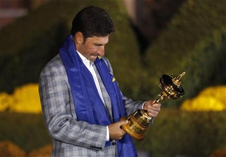 Team Europe captain Jose Maria Olazabal of Spain looks at the names on the Ryder Cup after the closing ceremony of the 39th Ryder Cup at the