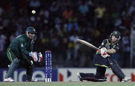 Australia's Matthew Wade (R) plays a shot as Pakistan's wicketkeeper Kamran Akmal watches during their Twenty20 World Cup Super 8 cricket ma