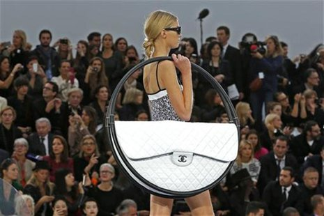A model presents a creation by German designer Karl Lagerfeld for French fashion house Chanel as part of his Spring/Summer 2013 women's read