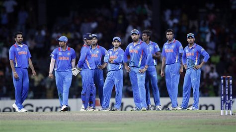 India's players stand on the field after a dismissal decision was reversed and South Africa's Robin Petersen returned to the crease during t